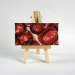 """Angela Faustina, Pomegranate XXIV, 2015. Oil on cradled painting panel with wooden easel, 4"""" by 2""""."""