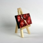 """detail of Angela Faustina, Pomegranate XXIV, 2015. Oil on cradled painting panel with wooden easel, 4"""" by 2""""."""