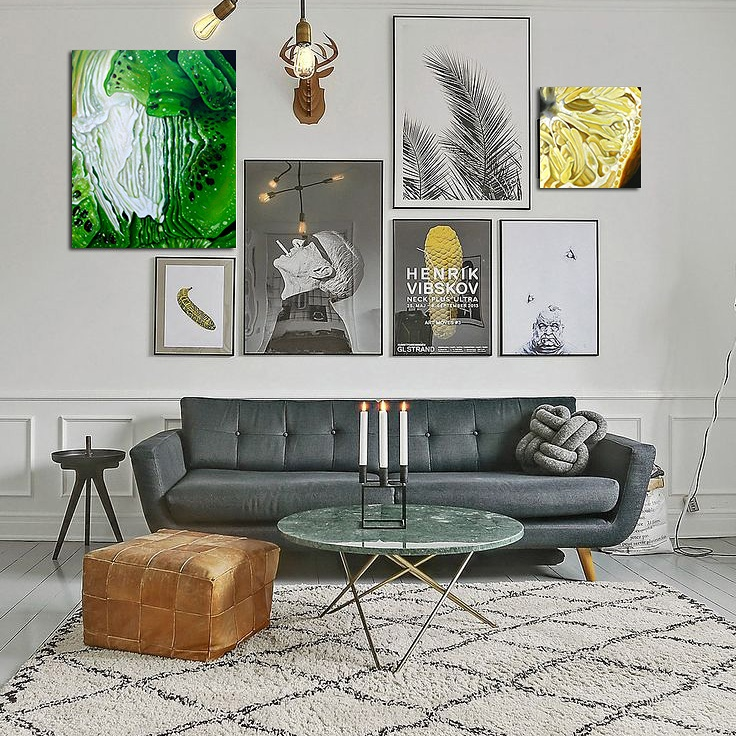 Angela Faustina's oil paintings Kiwi I and Lemon I hanging in situ on a gallery wall in a contemporary living room.