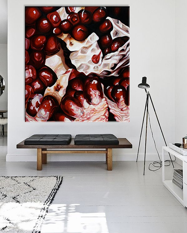 Angela Faustina's oil painting Pomegranate X hanging in situ in a modern living room.