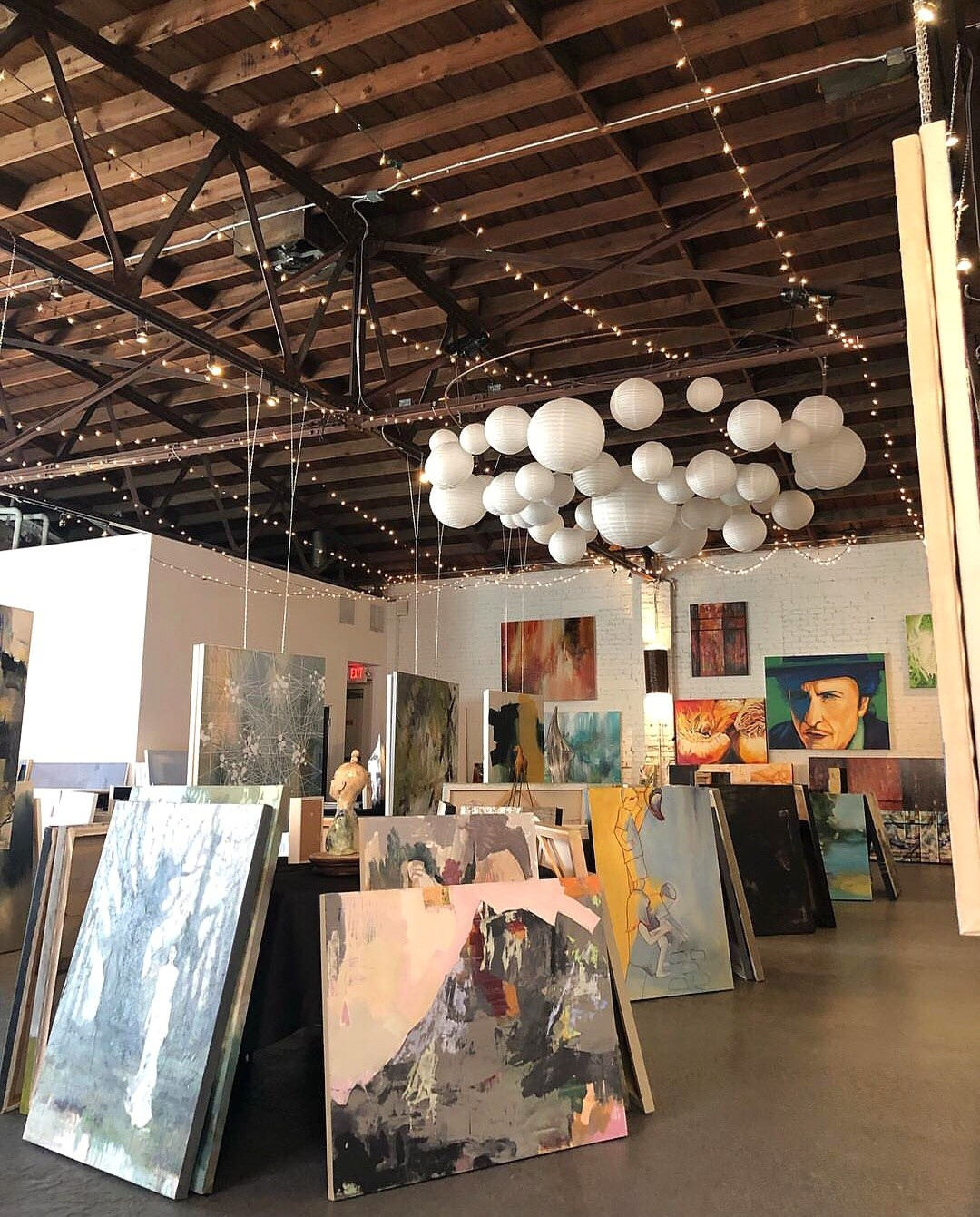 Angela Faustina and other artists paintings at For the Love of Art 3 Day Popup Show, Marietta, GA, 2018